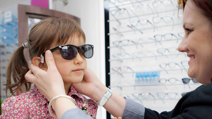 Child trying on sunglasses