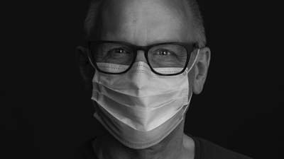 Man wearing face mask and glasses