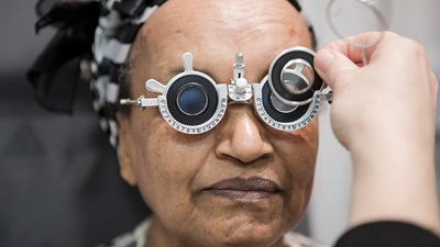 elderly woman having eye test
