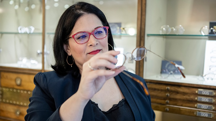 Optometrist holding a pair of glasses