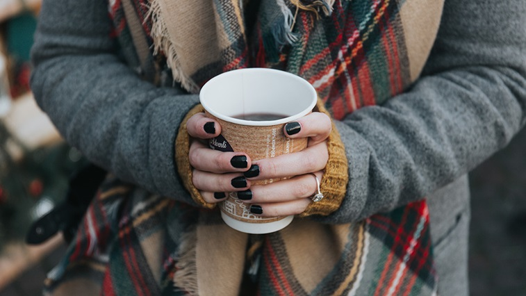 hands holding hot drink