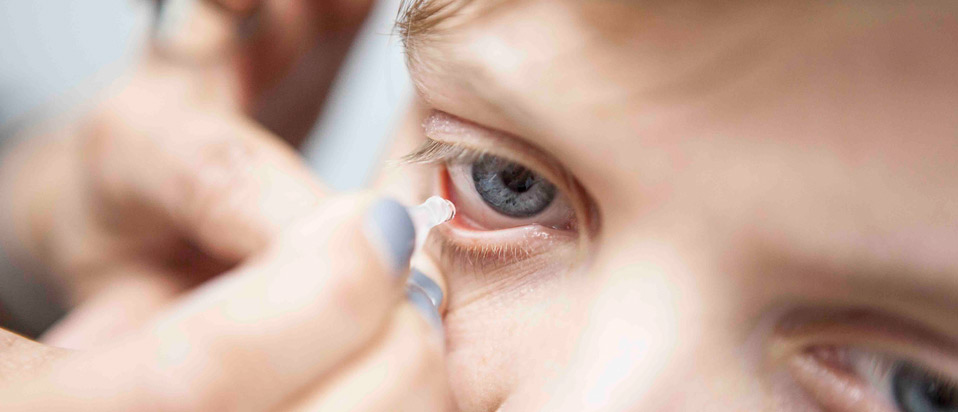 Eye drops being used