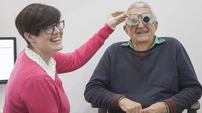 Elderly man with optometrist