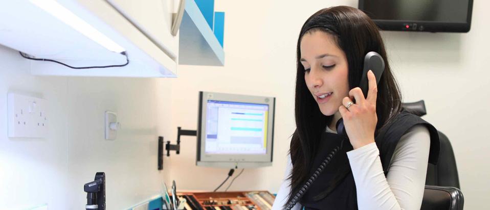 Optometrist making a telephone call