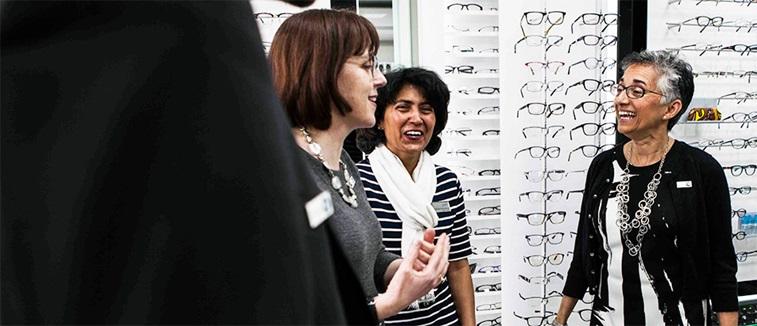 Optometrists chatting and smiling