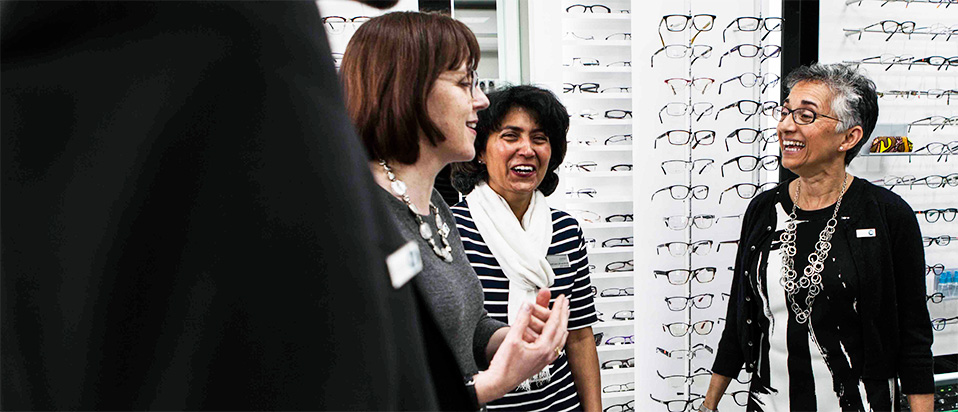 Optometrists chatting and smiling