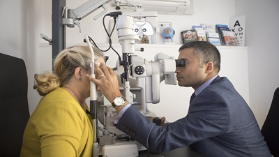 Optometrist carrying out an eye test