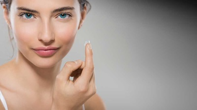 Lady with contact lens on finger