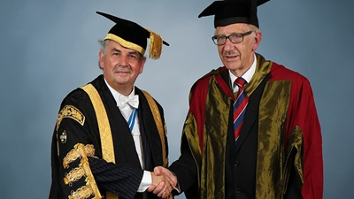 Richard Roberts (right) with UWTSD's vice chancellor Medwin Hughes (left)