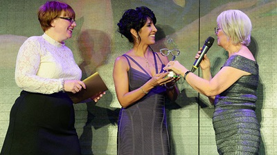 Michelle and Rubena pick up the Dame Mary Perkins Award at the Specscavers Spectacle Wearer of the Year Awards