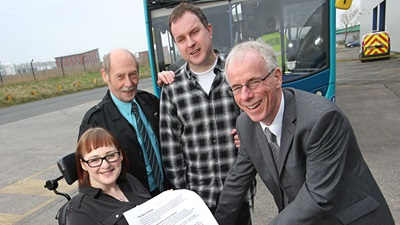Arriva representatives with RNIB campaigners signing the RNIB's bus charter
