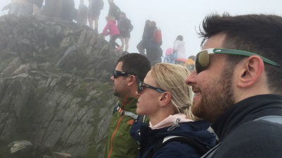 Lenstec Optical staff climbing Snowden