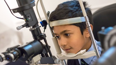 Young boy having sight test