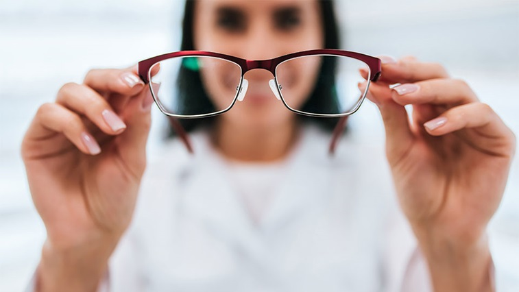 A women holding spectacles