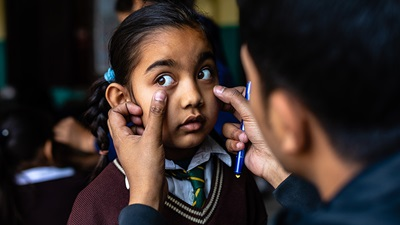 Child in Nepal having her eyes screened