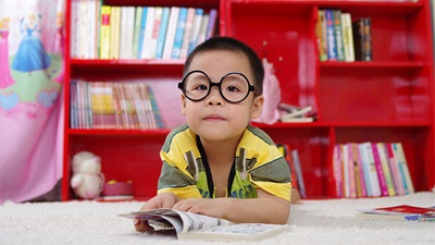 A small child wearing spectacles
