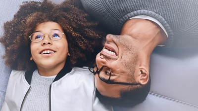 child and man wearing glasses