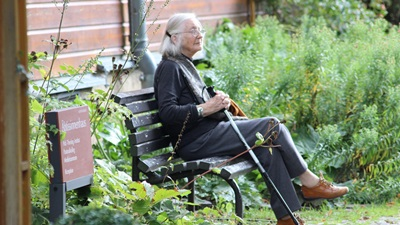elderly woman on bench