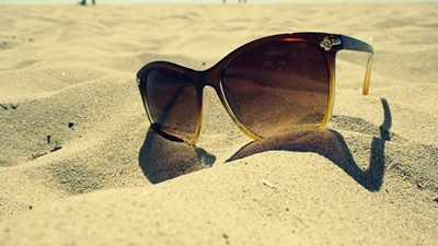 Sunglasses in the sand