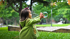 girl catching bubbles