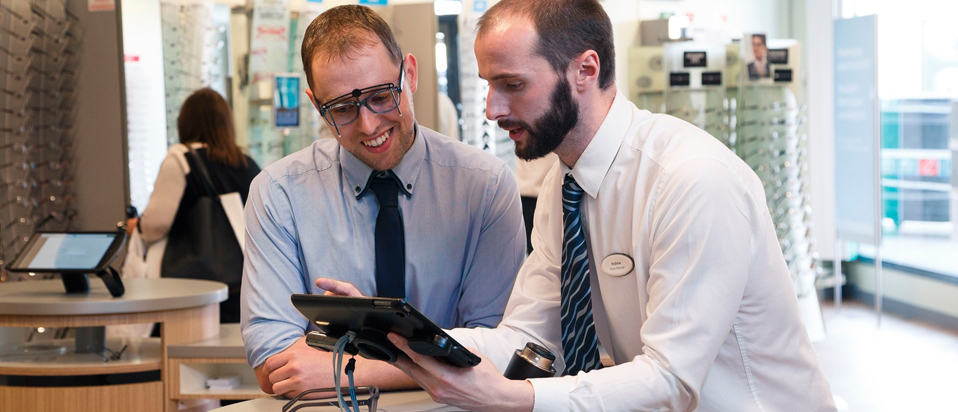 Specsavers staff looking at ipad