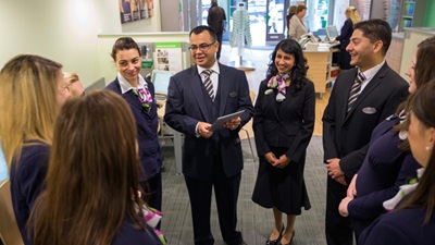 Specsavers staff gather on shop floor