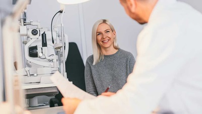 Optometrist and patient talking