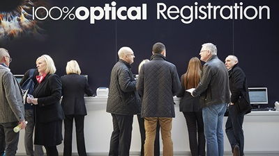 People at the registration desk at 100% Optical 2015