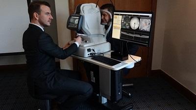 Leightons Opticians employee on OCT