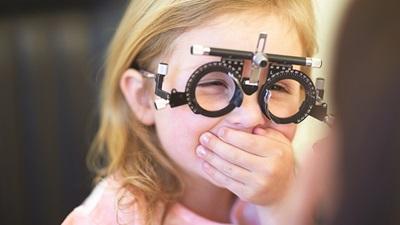 Child wearing test frames