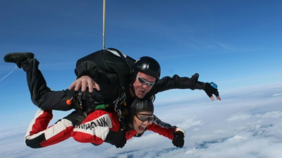 Wirral opticians skydive for cancer charity