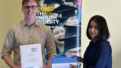 Plymouth University student Zeno Ivory collects his prize from Keeler