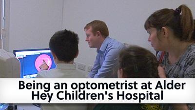 Optometrist speaking to children at Alder Hay