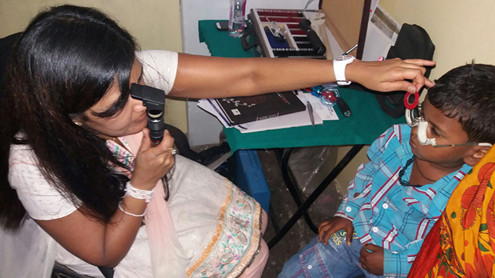 Rajula Karania treating a patient in India