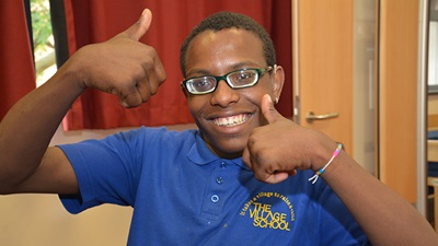 Children wearing spectacles giving the thumbs up