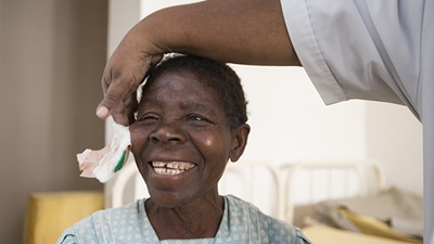 Woman receives eye care treatment