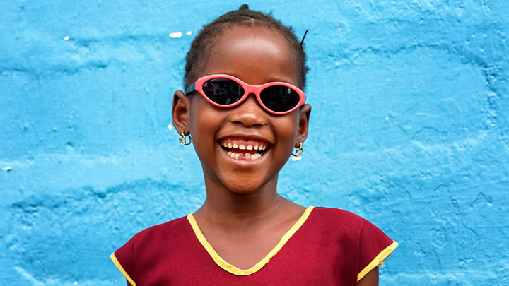 A young girl wearing glasses