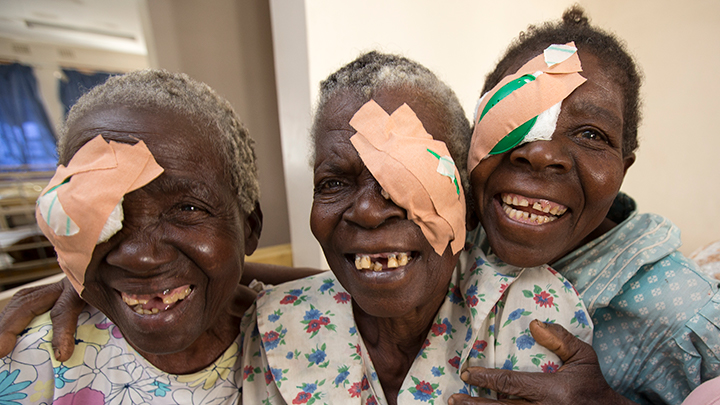 Women with their eyes patched following cataract surgery