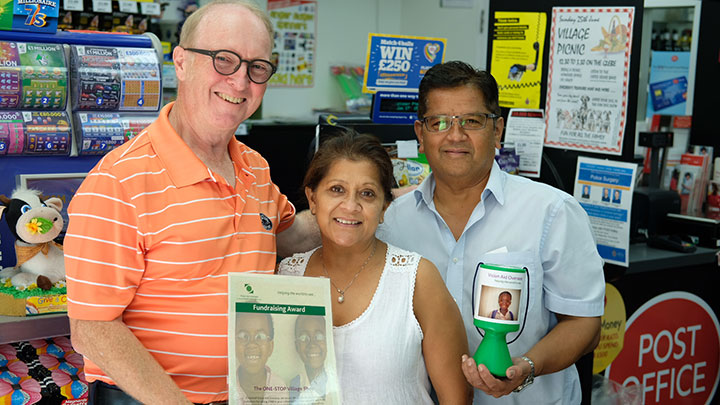 Nigel Burnett Hodd pictured (left) with shop owners Minal Amin and Mukesh Amin