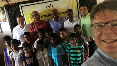 Nick Rumney with optometrists in India