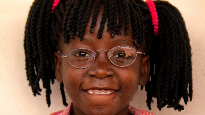 Young girl wearing spectacles