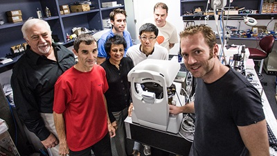 The late Professor Brien Holden  (left) with the BHVI technology team,  including Arthur Ho (third from the right)