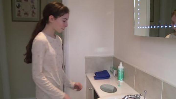 Teenage girl in bathroom