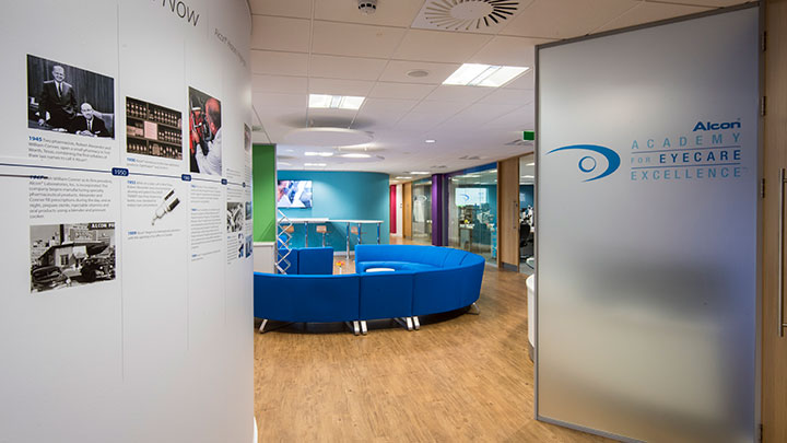 Clinic waiting room with Alcon banner