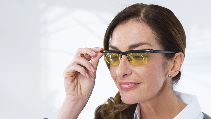 Women wearing Adlens frames
