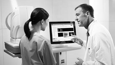 Optometrists using a computer
