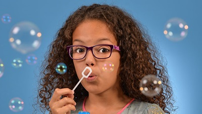 Model wearing Continental Eyewear children's frames