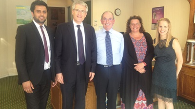 Andrew Jones (second from left) visiting Page & Smith Opticians in Harrogate, Yorkshire
