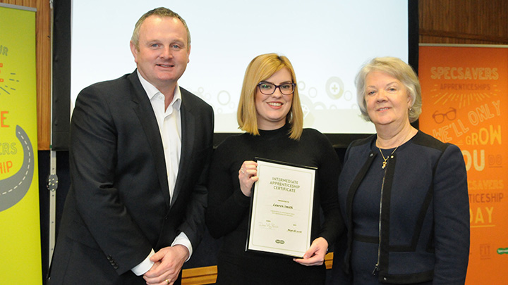 Lauren Smith accepts award at Specsavers graduation ceromony