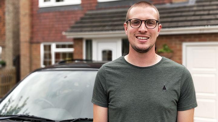 Man standing next to a car